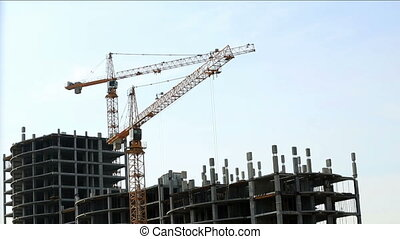 Construction site. View of cranes on sky backdrop