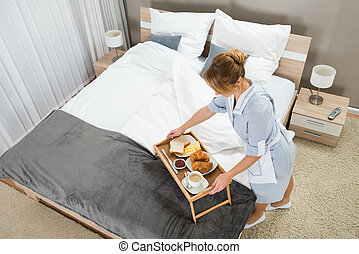Maid With Breakfast Keeping On Tray Table - High Angle View...
