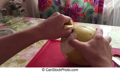 Man hands clean pomelos fruit peeled Time lapse