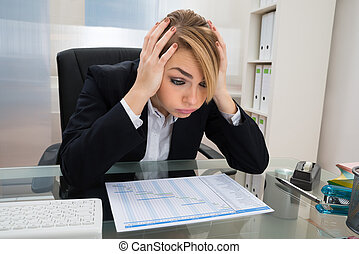 Businesswoman With Gantt Progress Chart At Desk - Portrait...