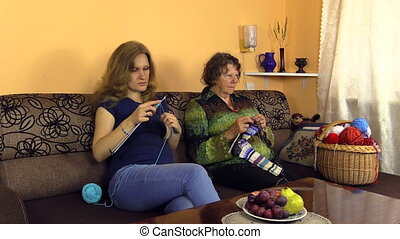 woman knit needle craft - grandmother with granddaughter...