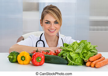 Female Dietician With Vegetables - Portrait Of Female...