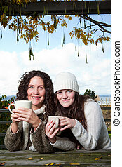 Mother and daughter - A portrait of a happy mother and...