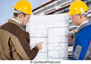 Two Architects Discussing Plan