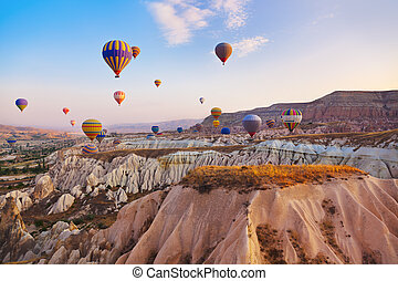 Hot air balloon flying over Cappadocia Turkey - Hot air...