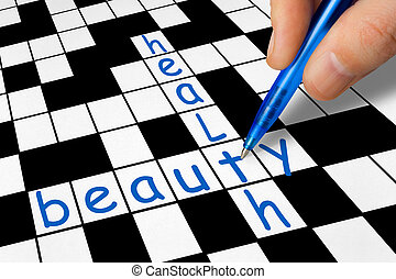 Crossword - health and beauty - Hand filling in crossword -...