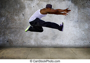 Urban Black Man Jumping High - Black urban hip hop dancer...
