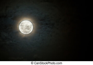 Scary moon on dark and cloudy night with halo - Scary moon...