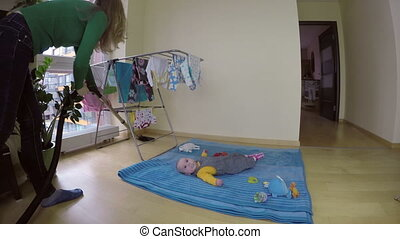 Nanny work near baby - nanny woman look after newborn baby...