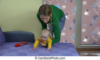 mother baby massage - mother swipe little baby girl finger...