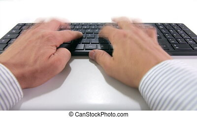 hands typing on keyboard - close up of male hands typing on...