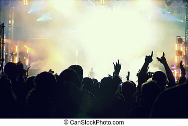 Cheering crowd in front of stage lights - retro photo -...