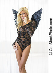 Blonde Lingerie Model with Wings - An attractive blonde...