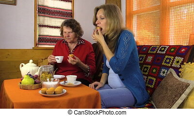 woman granny tea cake - young pregnant woman visiting his...