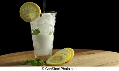 Cold Lemonade with Ice - Cold Lemonade Poured into a Glass...