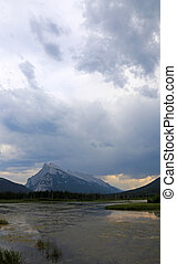 Rundle and Clouds - Mount Rundle and clouds reflecting in...