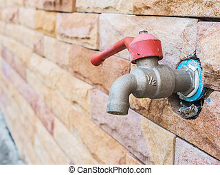 water tap - Dirty water tap on stone brick wall
