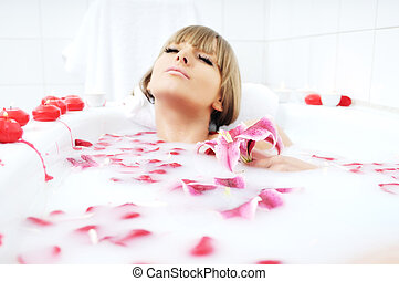 woman bath flower - woman beauty spa and wellness treathment...