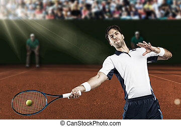 Tennis Player - Tennis player playing on a clay tennis court...