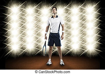 Tennis Player. - Tennis player playing in front of lights.