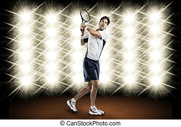 Tennis Player - Tennis player playing in front of lights