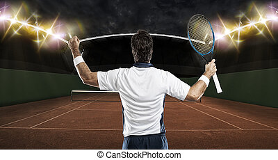 Tennis Player - Tennis player celebrating, on a clay tennis...