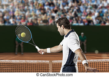 Tennis Player - Tennis player returning a ball on a clay...