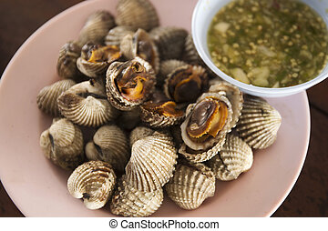 Boiled cockles and spicy sea food sauce in Thai Style