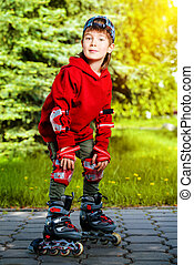 rollerblade - Cool 7 year old boy rollerblades on the...