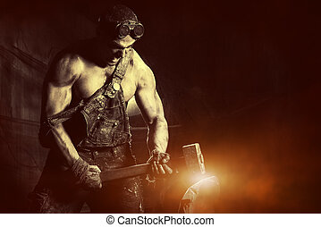 smithy - Rage muscular coal miner working with a hammer over...