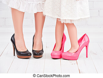 legs mother and daughter little girl fashionista in pink...