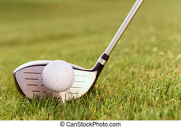 Golf club and ball on tee - Typical combination Close up of...