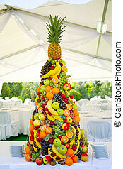 wedding banquet - pyramid with tropical fruit on the wedding...