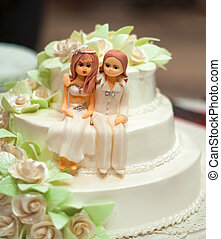 Wedding cake, sitting on it with figures of people - the...