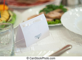 Nameplate on wedding - White name tag on the holiday table