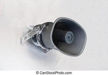 Loudspeaker - Grey loudspeaker hanging on a white wall