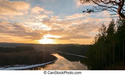 Winter sunset over the river, time-lapse