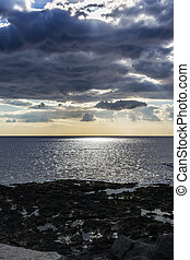 Sky with clouds over black sea at Giardini-Naxos, Sicily,...