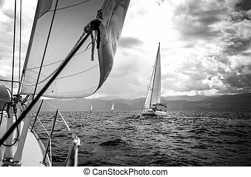 Sailing yachts in the sea in stormy weather. Black and white...