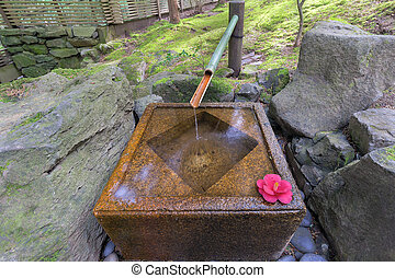Tsukubai Water Fountain in Japanese Garden - Tsukubai Water...