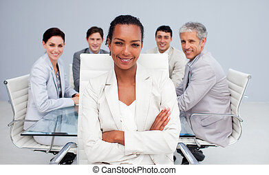 Happy Afro-American businesswoman in a meeting with her team