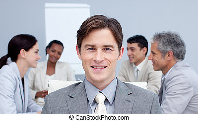 Portrait of an attractive busienssman smiling in a meeting