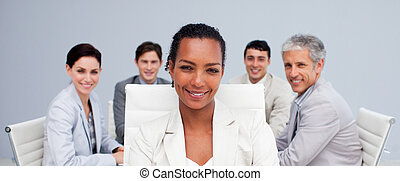Afro-American businesswoman smiling in a meeting with her...