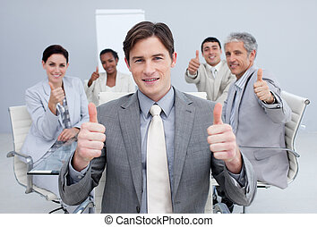 Attractive businessman celebrating a sucess with his team in...