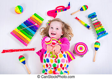 Little girl with music instruments - Child with music...