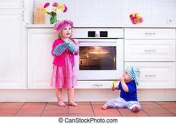 Kids baking in a white kitchen