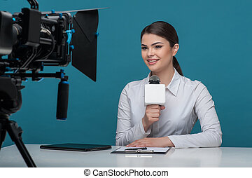 Beautiful girl tv newscaster with pretty smile reports