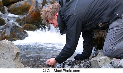 Drinking from a stream - Drinking water from a pure mountain...