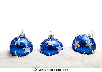 Three blue christmas balls in the snow - isolated - Three...