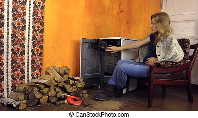 pregnant woman stove - Beautiful pregnant woman caress her...